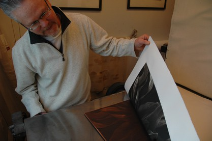 Tom Baril checking a photogravure.